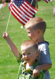 by: file photo, Young tykes share their patriotism during last year's Fourth of July celebration in Lake Oswego.