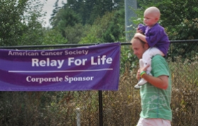 by: FILE PHOTO Vern Uyetake, Grady Newsome, then 3, hitches a ride on his father Brooks' shoulders. Both Newsomes started last year's relay by participating in the survivor lap around the track at Lake Oswego District Stadium. Grady Newsome battles leukemia.