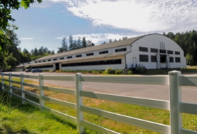 by: Vern Uyetake, Discussions are ongoing about the possible purchase or trade of Lake Oswego Hunt Inc. by the city of Lake Oswego. Shown is the club's first indoor arena, which is considered to be the oldest and largest wooden arena in the West.