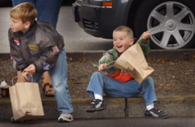 by: Vern Uyetake, Ethan, 6, and Kale, 3, Loun of West Linn eagerly wait for the parade to pass by and reward them with a shower of candy