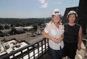 by: Vern Uyetake, Candace Kramer and Becky Hamilton, both brokers with Windermere and marketing the 555 Second Street condos, admire the view from one of the balconies. They said that on the building's grand opening hard hat tour last month, 300 people toured the development.