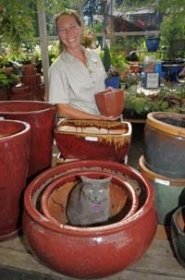 by: Vern Uyetake, Nicole Forbes — along with the garden cat Amos — spends time walking the isles of pottery for sale.