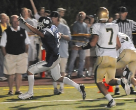 by: Vern Uyetake, Lake Oswego's Micah Hatfield raises a victory salute as he enters the endzone after his reception gave the Lakers the win in the closing seconds of Friday's match-up with top ranked Jesuit.