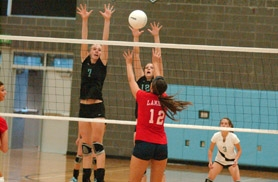 by: MATTHEW SHERMAN, Lakeridge's Lexi Ross and Sarah Grewenow go for a block in Lakeridge's four-set win last Wednesday.