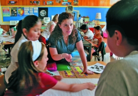 by: Tribune file photo, Atkinson Elementary School teacher Ruth Tucker works with students, many of whom are non-English speaking, during science class. Bill Sizemore's ballot initiative seeks to end bilingual education in Oregon and put students into English immersion classes.
