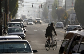by: L.E. BASKOW, With bicycles and cars sharing the road more often, such as here on Southeast Hawthorne Boulevard during morning rush hour, it's easy for tempers to flare.
