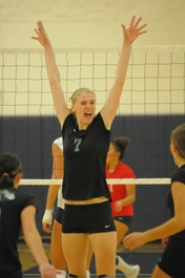 by: VERN UYETAKE, Lakeridge's Lexi Ross celebrates after the Pacers won a big point in last week's dramatic five-set victory over Lake Oswego.