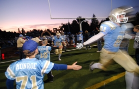 by: VERN UYETAKE, Lakeridge Senior Daniel Chesney and the rest of the Pacers were greeted by eager fans as they took the field for Friday's historic game.