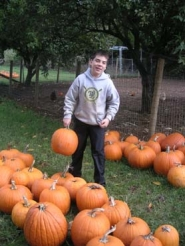 by: Nicole DeCosta, Tucker Hamilton, 12, said his family displays pumpkins on hay bales and a wagon.