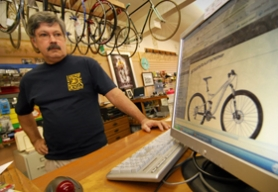 by: Vern Uyetake, Gordon Haber, owner of Lakeside Bicycles on North State Street, shows a limited edition Bianchi bicycle named for cyclist Danilo DiLuca. One like it was among six bikes stolen from his shop Friday, Oct. 24.
