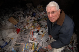 by:  VERN UYETAKE, Raymond Petermeyer stands in a bin of recycled magazines and newspapers. The 83-year-old owner of Portland Recycling faced closing the company's recycling centers at the end of 2008, including one in Lake Oswego. Market forces, combined with declining newspaper sizes and sales and aggressive curbside recycling programs, have eaten away the company's small profits. Portland-based Far West Fibers plans to acquire Portland Recycling and carry it through the recession.