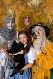 by: David Kinder, Greg Talbott as Tin Man, Colin Keating as Cowardly Lion, Brandon Vance as Scarecrow, Jesselyn Parks as Dorothy, and Happy as Toto.