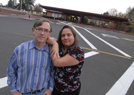 by:  VERN UYETAKE, Bob Keller and Cynthia Mohiuddin hope that litigation will help their third-grade son, who was placed in a special education classroom, attend a regular class in his neighborhood school, Palisades Elementary, shown behind the couple.