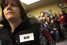 "by: JAIME VALDEZ, Jody Vanegas, Lake Grove, wears a ""No"" sticker while wait-ing to testify about Stars Cabaret at the Tualatin City Council meeting Monday."