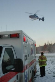 by: Lake Oswego Fire Department, A Life Flight helicopter carrying a 16-year-old boy injured in a Westlake-area sledding accident in Lake Oswego Tuesday heads for Legacy Emmanuel Hospital from a soccer field.