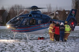 by: COURTESY OF LAKE OSWEGO FIRE DEPARTMENT, An Life Flight helicopter carrying a 16-year-old boy injured in a Westlake-area sledding accident in Lake Oswego Tuesday gets ready for the flight to Legacy Emmanuel Hospital from a soccer field off Carman Drive.