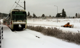 "by: L.E. BASKOW, A snow plow creeps along Interstate 205 at the Northeast Sandy Boulevard interchange as a MAX train sits ""out of service"" during recent snowstorms. Letter writers offer advice for better operations of MAX."