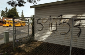 by: L.E. BASKOW, A home along Southeast Division Street near 130th is tagged with gang graffiti. City Commissioner Dan Saltzman and Police Chief Rosie Sizer write that the city is working with other agencies to combat growing gang violence.