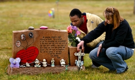 by: L.E. BASKOW, Miriah Gillett, the sister of Oregon City girl Miranda Gaddis, murdered seven years ago, recently visits Miranda's gravesite with friend, Justin Evans.