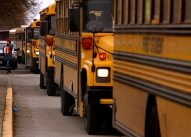 by: L.E. BASKOW, School buses line up for parking as thousands of students and adults convene on the Oregon state capitol steps for a February rally for K-12 education. There are wide-ranging views on how education funding needs to change during the economic crisis.