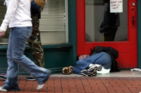 by: Jim Clark, A man sleeps in the doorway of an empty office entryway in downtown Portland. Co-chairs of the former mayor's SAFE committee write that the city's ordinance prohibiting obstructing sidewalks includes help for the homeless.