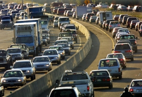 by: TRIBUNE FILE PHOTO: JIM CLARK, Morning traffic backs up on U.S. Highway 26, near Oregon Highway 217. Automobile emissions are among the many forms of carbon emissions contributing to climate change.