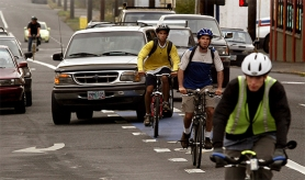 "by: Tribune File Photo, Bicycle and cars try to share the road along Hawthorne Boulevard. Letter writers offer opinions about a Portland insurance brokerage that is rolling out a ""pay-as-you-drive"" auto insurance policy that is cheaper for people who drive less."