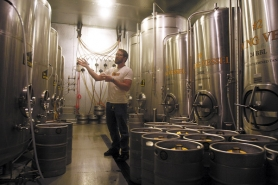 by: JONATHAN HOUSE, Hopworks Urban Brewery owner and brewmaster Christian Ettinger stands in the freezer where beer is stored after the brewing process. A My View writer decries a proposed increase in state beer taxes, writing that it will hurt the state's microbrewing industry, and writes that the state must become more business-friendly.