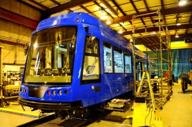 by: Courtesy of United Streetcar LLC, Workers with United Streetcar LLC of Clackamas, a subsidiary of Clackamas Ironworks, put the finishing touches on a streetcar to be delivered to the city of Portland.