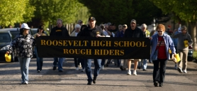 by: L.E. BASKOW, Roosevelt alumni, parents and supporters marched from the campus in North Portland to Jefferson High School on May 16, where they converged on a public meeting to discuss high schools. They marched to protest the school district's decision to reassign Roosevelt Principal Deborah Peterson away from the school.