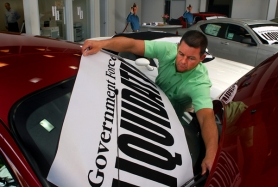 "by: L.E. BASKOW, Alex Laws, co-owner of Portland's Timberline Dodge, in May places banners on the dealership's cars reading ""Government Forced Liquidation."" Chrysler's bankruptcy is eliminating the Laws family's dealership, the only Chrysler dealer in Portland."