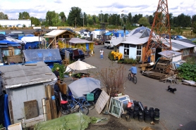 by: JIM CLARK, What began as a group of tents has become a collection of homes built from recycled items at Dignity Village. A letter writer is in favor of creating more Dignity Villages in outlying areas of Portland so the city's homeless have a place to go.