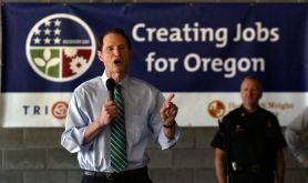 by: L.E. BASKOW, Sen. Ron Wyden speaks to the crowd that gathered for the May groundbreraking of the stimulus-funded TriMet Police south precinct. One letter writer says the federal stimulus money is doing no good.