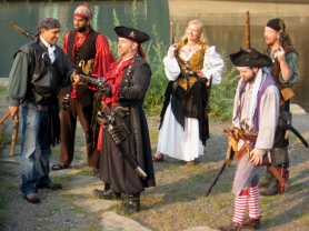 by: COURTESY OF Byron Dazey, (Top) Shuhe Hawkins (red bandanna) and Kate Larsen (blonde woman) and the BOOM Pirates put on reenactments and fans and their accessories revel at the the Portland Pirate Festival.
