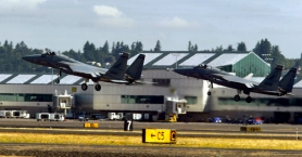 by: Tribune File Photo, A pair of F-15 fighter jets depart the Oregon Air National Guard base at PDX for a training flight. Some Cully neighbors oppose the additional flyovers; others don't mind too much.