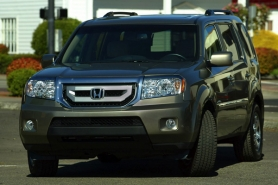 by: L.E. BASKOW, Honda has its sight set on families with its mid-size SUV, the eight-passenger Pilot.