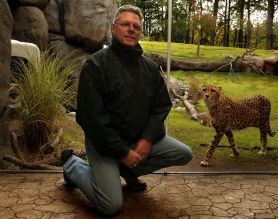 by: L.E. BASKOW, Chris Pfefferkorn, the Oregon Zoo's general curator, has a particular fondness for cheetahs.