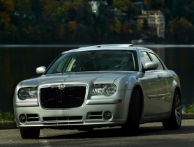 by: L.E. BASKOW, The SRT8 package gives the Chrysler 300C the punch to back up its aggressive looks.
