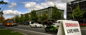by: L.E. BASKOW, Traffic flows steadily about Orenco Station near the westside MAX light-rail line. Orenco is an example of the type of transit-oriented, mixed-use projects that Metro envisions for the region. Letter writers, however, don't agree that such development is the most appropriate way for Portland to grow.