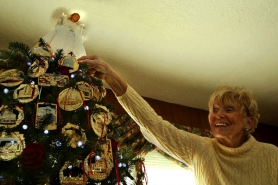 by: L.E. BASKOW, Christmas ornament artist and designer Betty Woods Gimarelli has produced 24K gold-plated Portland ornaments since 1989. Her tree at home shows off many of the pieces created in the past 20 years, gaining her worldwide recognition.