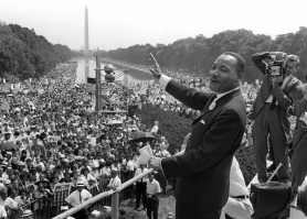 "by: COURTESY OF AFP Getty Images, Dr. Martin Luther King Jr. waves to supporters from the steps of the Lincoln Memorial in August 1963 during the March on Washington. It has been 40 years since King's famous ""I Have a Dream"" speech. King died by an assassin's bullet in April 1968."