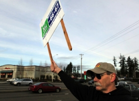 by: JAIME VALDEZ, Dan Bozich of Tigard asks motorists along Southwest Lower Boones Ferry Road to vote Yes on Measures 66 and 67. Two My View writers weigh in on the volatile tax issue. A Jan. 26 special election will decide the issue.