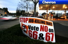 by: L.E. BASKOW, Gas stations, such as the Chevron on Southeast Powell Boulevard in Portland, are among many businesses working to defeat  Measures 66 and 67. Voters this month are being asked to ratify or reject the measures, a referendum on the 2009 Legislature's income and business tax increases.