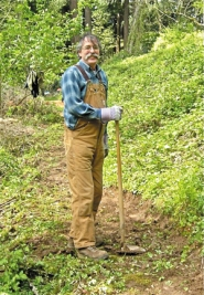 by: Courtesy of Leach Botanical Garden, Volunteer George Taylor works on the trails at Leach Botanical Garden.