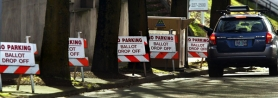 by: L.E. BASKOW, Multnomah County elections officials clear a street near their offices to collect ballots in Tuesday's special election.