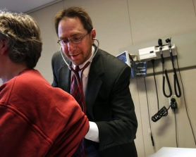 by: Jim Clark, Internist Chuck Kilo examines a patient at GreenField Health in Southwest Portland. Kilo started the innovative clinic nine years ago, but left in March to become chief medical officer at Oregon Health & Science University.