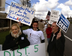 by: L.E. BASKOW, Sarah and Dale Seale (from left), co-chairs of the Clackamas chapter of Americans for Prosperity, protest Democrats' plans to expand health-care insurance. The protesters rallied in March outside Democrat Kurt Schrader's Congressional town hall meeting in Oak Grove.