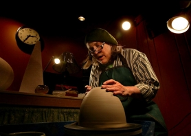 by: L.E. BASKOW, Victoria Shaw works on her pottery at the Stark Street Studios and Gallery in Southeast Portland. A former postulant and truck driver,