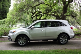 by: ANNI TRACY, Who says family life has to be boring? The Acura MDX looks sharp, drives well and pampers its passengers with luxury features.