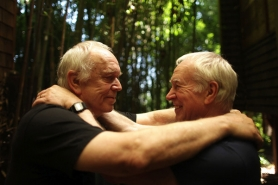 by: JAIME VALDEZ, Eric Marcoux (left) embraces his longtime partner of 57 years, Eugene Woodworth, at their Northwest Portland home. The two will share their knowledge at the Gay and Grey PDX Expo on Saturday, May 22.